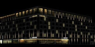 Fassade bei Nacht Amano Group