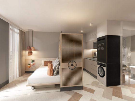Rendering einer Wohneinheit mit Bett, Kochnische und Badezimmer. Bild: SV Hotel AG